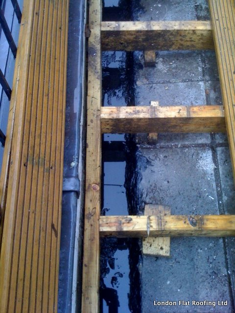 Epdm epdm rubber and liquid flat roofs page 4 for Leaking roof gutter