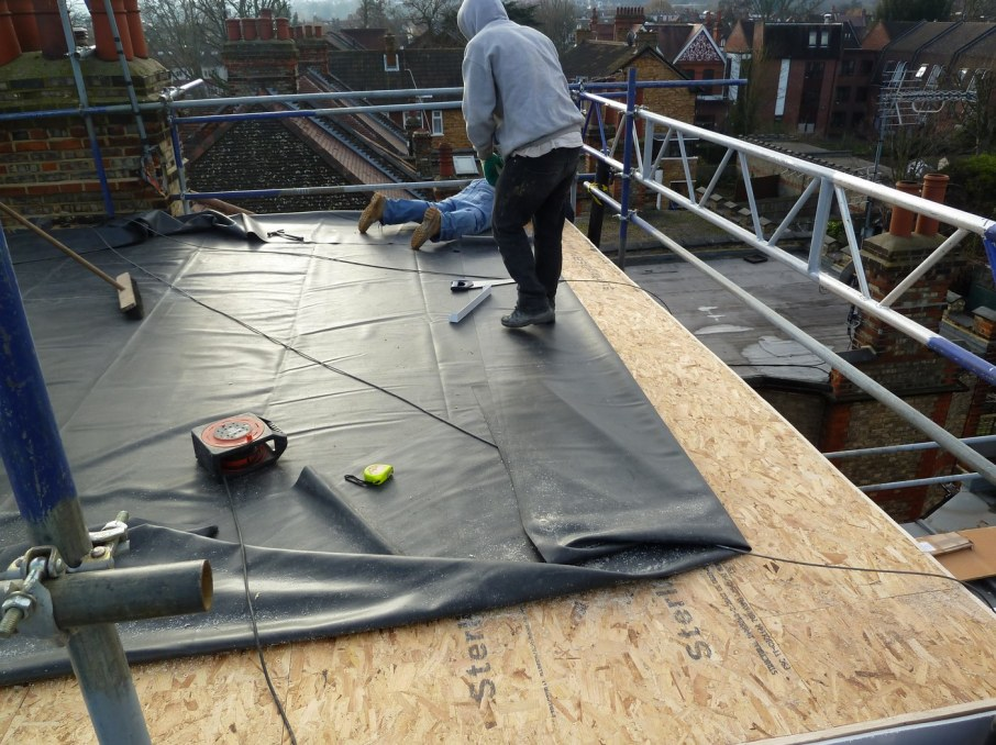 New epdm rubber flat roof going down over new osb roof for T g roof decking
